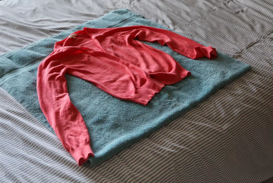 how to wash wool sweater by streching and drying