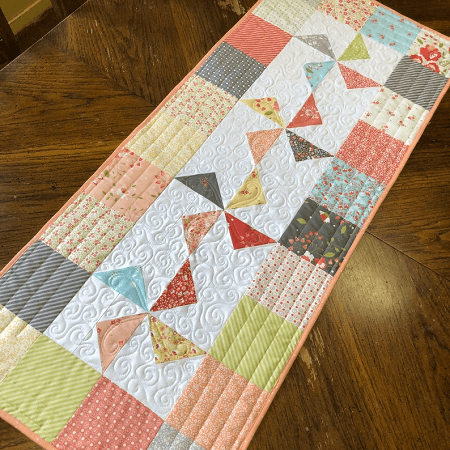 Windmills Charm Square Table Runner Pattern by Pamela Quilts