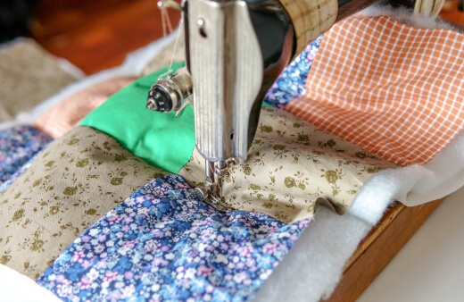 A quilting sewing machine has been designed for making quilts