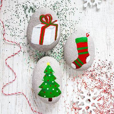 Around The Christmas Tree Painted Rocks by Deco Art